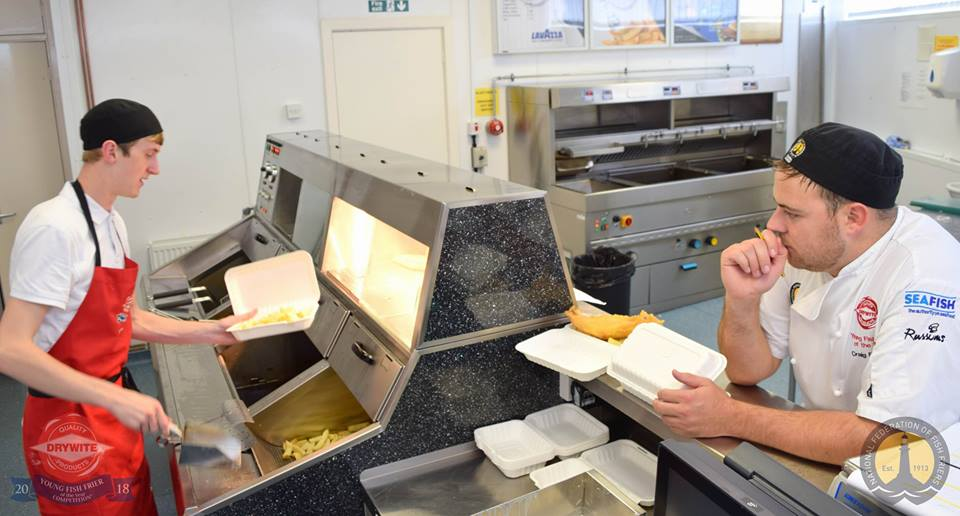 Brett is closely observed on the range by Craig Buckley, 2011 Young Fish Frier of the Year winner.