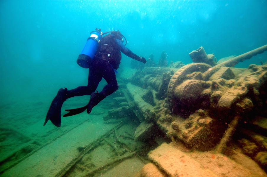 An NOF diver explores the wreck of the steam barge Monohansett in Thunder Bay.