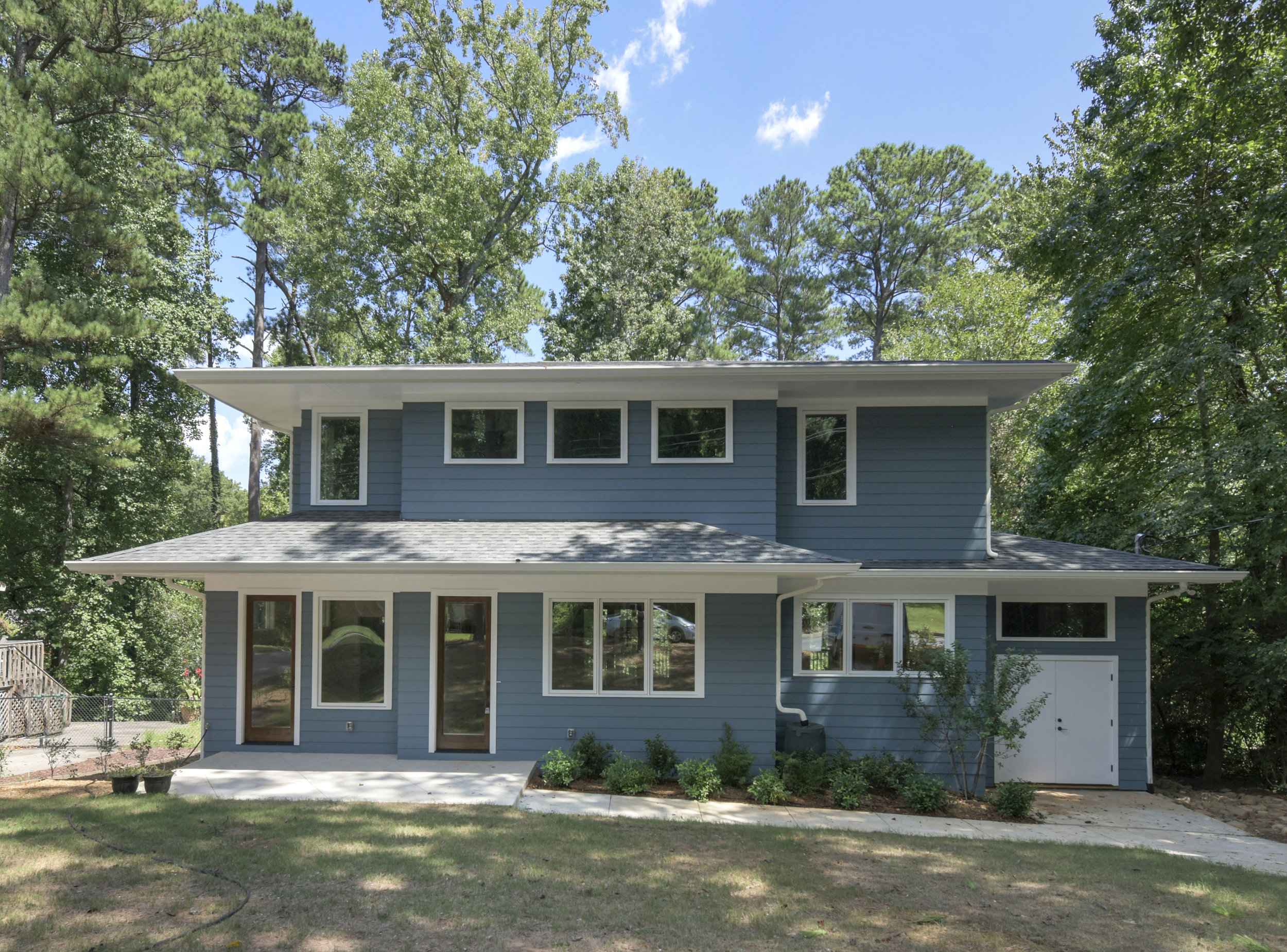 This Decatur home began as a modest 1950's style ranch with a carport and has now been transformed into an Eric Rawling designed Prairie-style home. The owner wanted to bring the feeling of the outside in. Only the exterior framing and foundation remained when we did this gut to studs renovation.