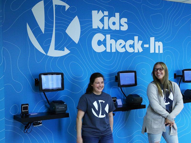 victory kids check in volunteers.jpg