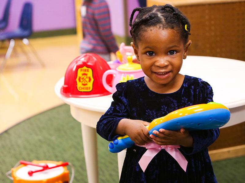 victory kids nursery girl smiling