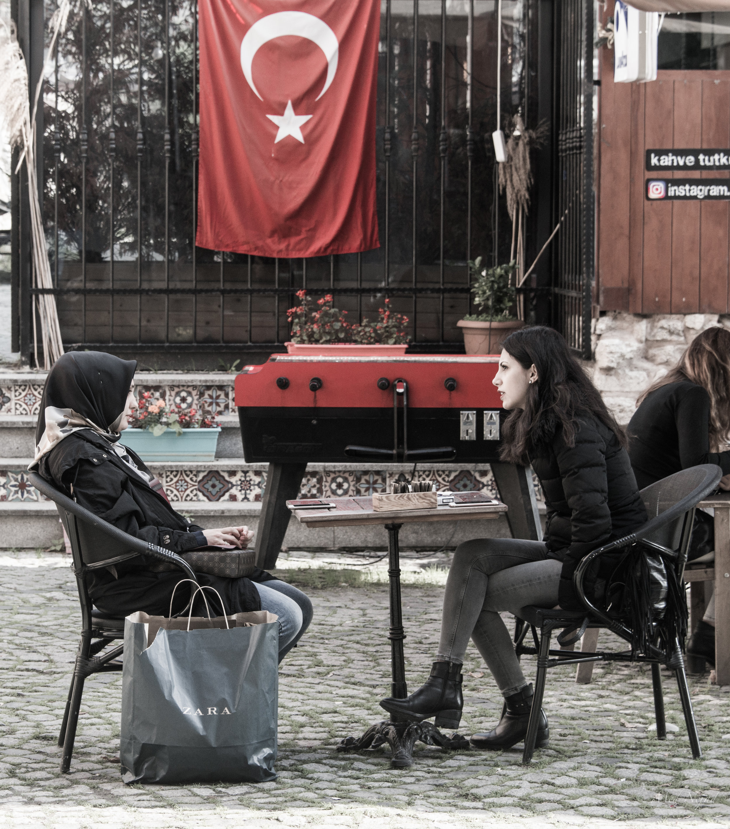Two women relaxing at an outdoor cafe in Lalali district in Istanbul