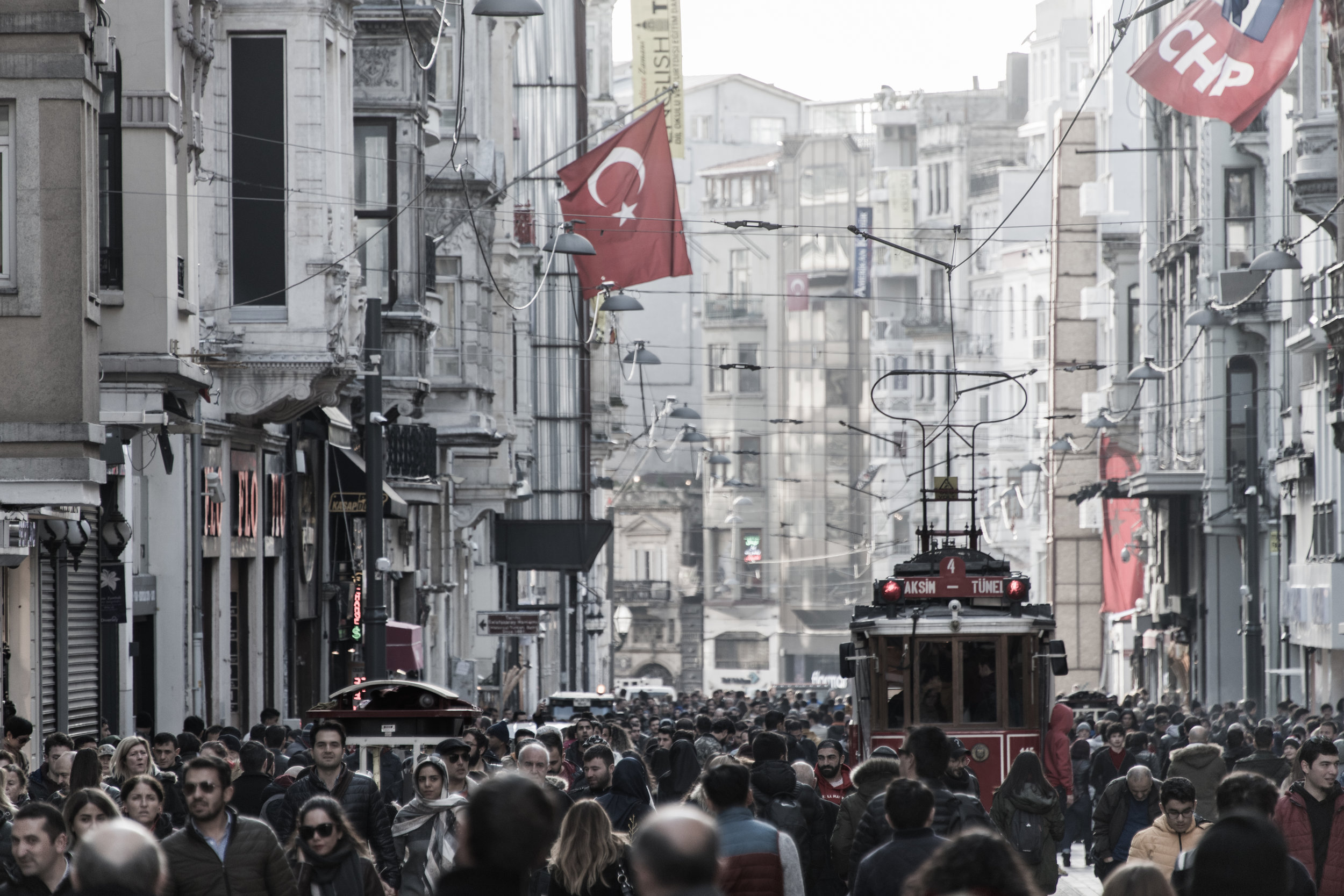 A historic tram in a busy winter afternoon in Istiklal Street