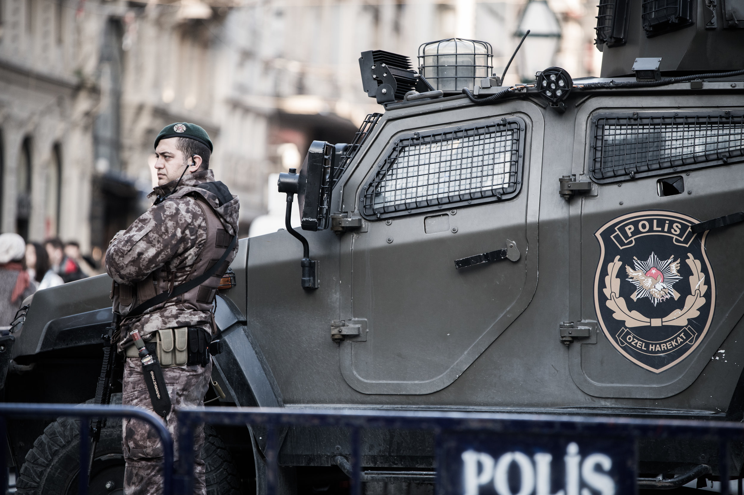 A Turkish security officer standing next to an armoured vehicle keeping a watchful eye in Istiklal Street