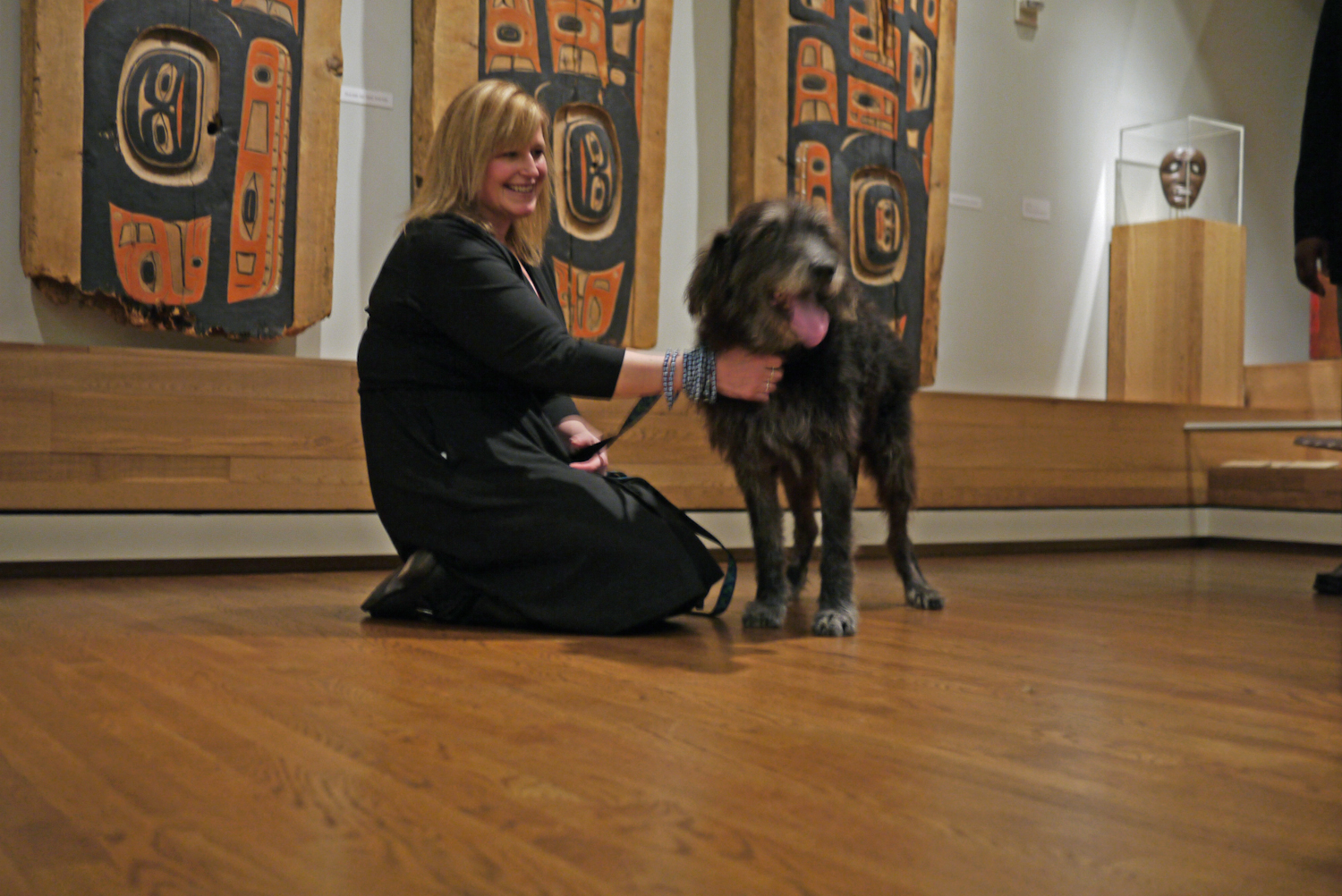 "Owner Amanda with dog Tyrone at ""House Panels"" by Unknown Tlingit artist, late 19th century. Image taken on March 13, 2013."