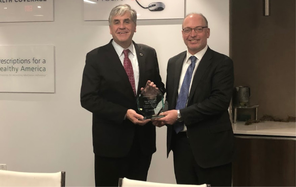 HHS Deputy Secretary Eric Hargan (left) receives CAHC's 2018 Affordability Champion Award from CAHC President Joel White (right).