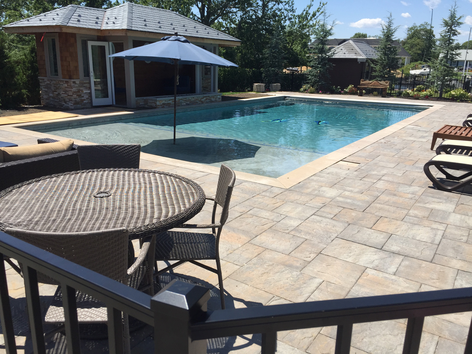 Professional pool area unilock paver design company in Long Island, NY