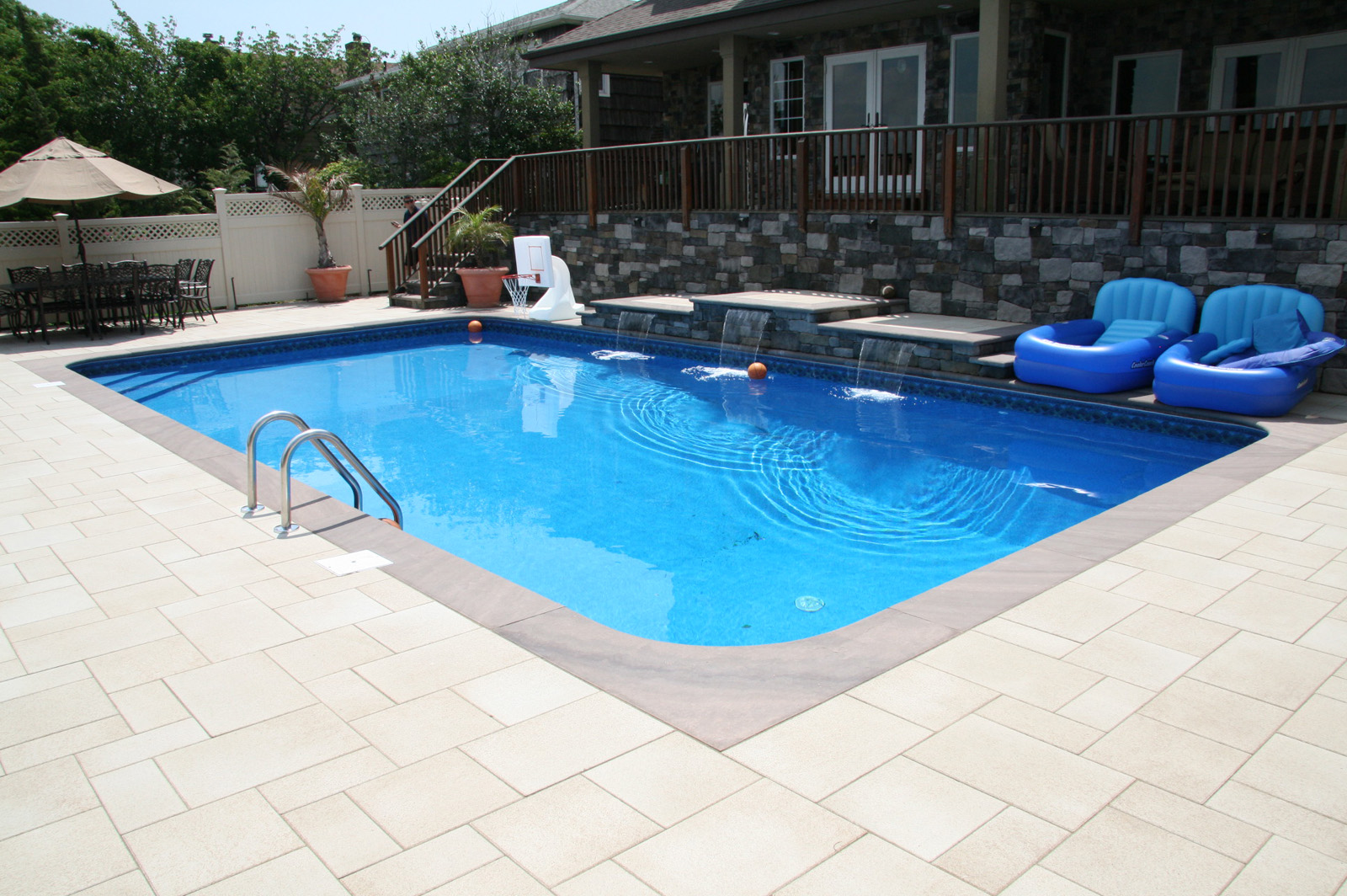 Professional landscape design with a pool waterfall in Long Island, NY
