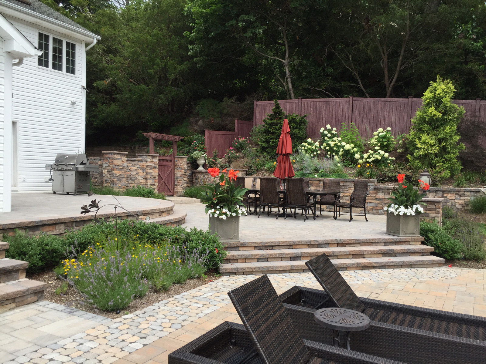 Professional landscape design with a vinyl fencein Long Island, NY