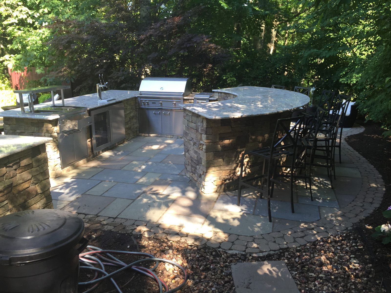 Landscape design with outdoor kitchen in Long Island, NY