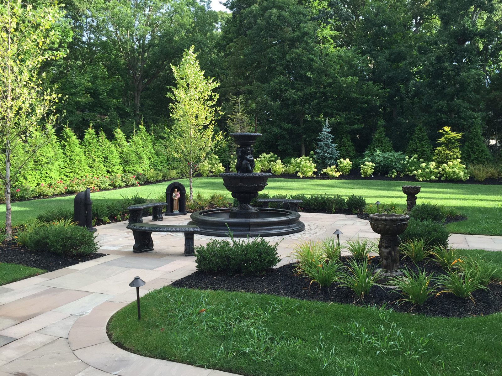 Landscape design with water feature in Long Island, NY
