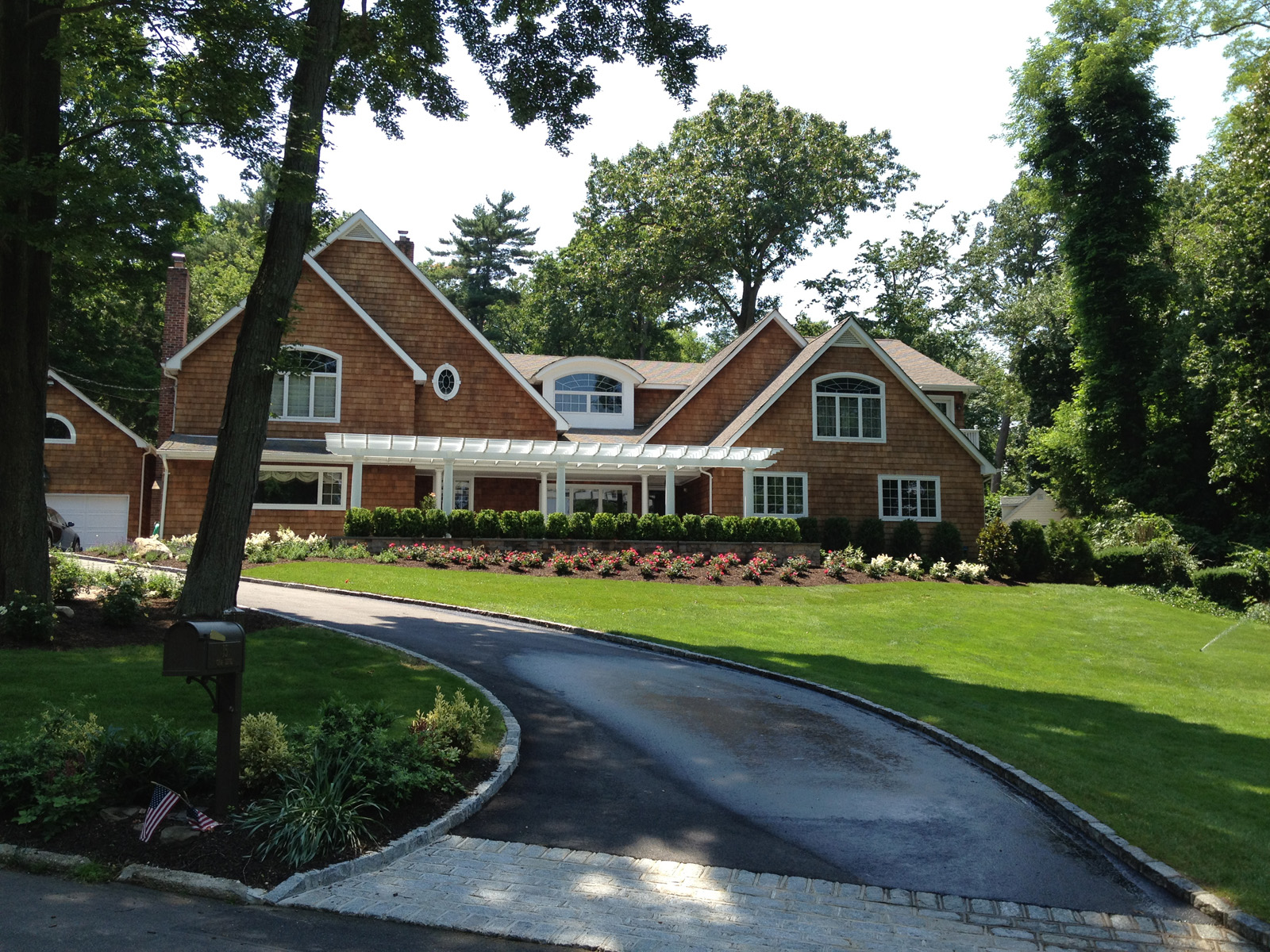 Landscape design with natural stone walkwayin Long Island, NY