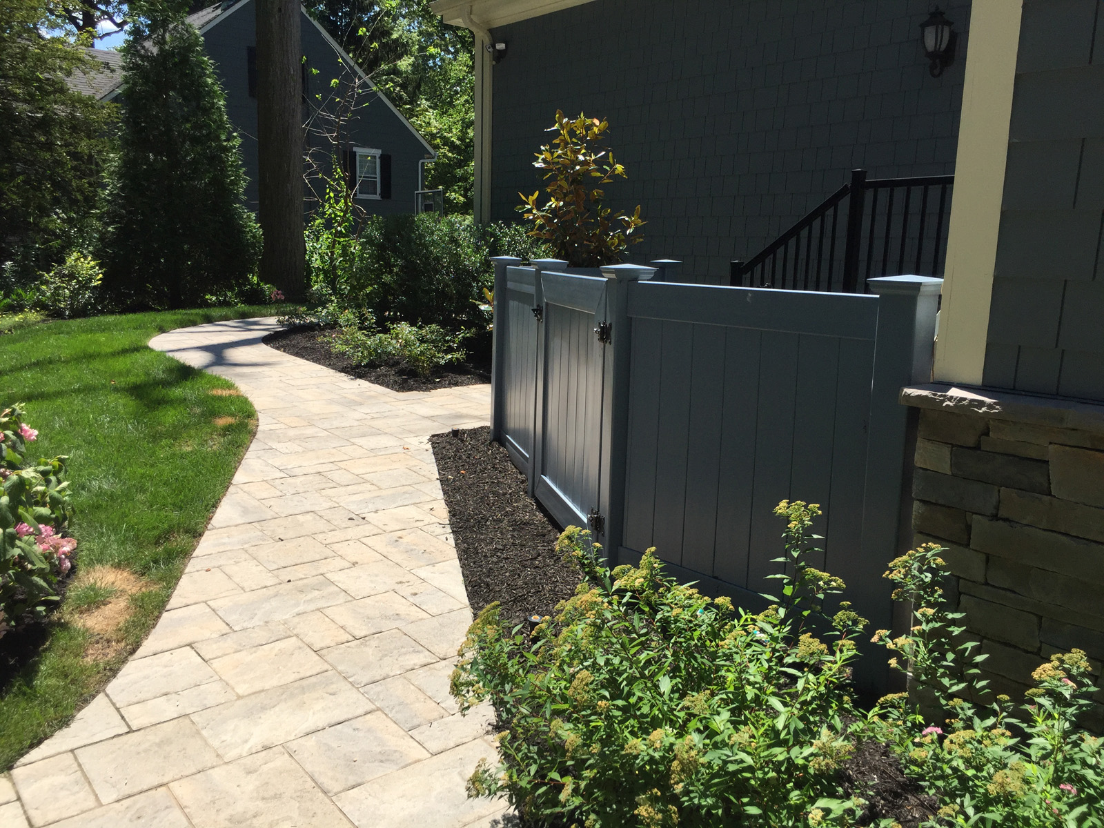 Landscape design with vinyl fence in Long Island, NY