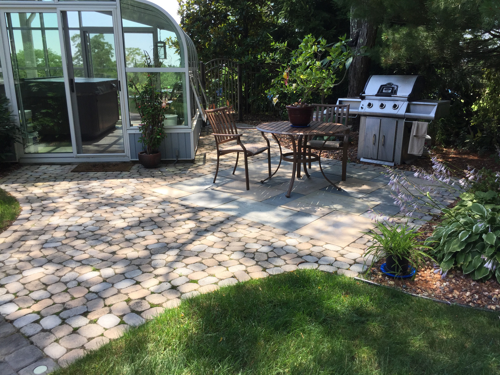 Landscape design with a waterfall in Long Island, NY