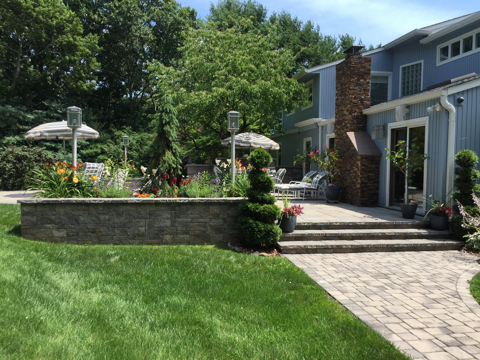 Landscape design with a walkwayin Long Island, NY