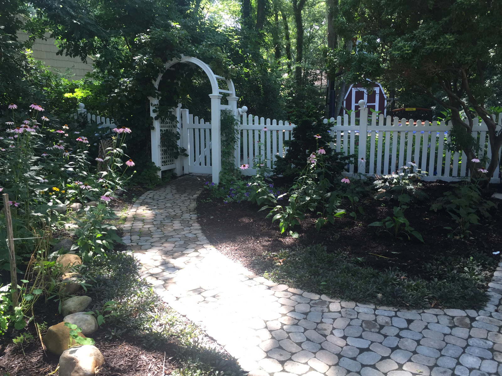 Top landscape design with picket fences in Long Island, NY