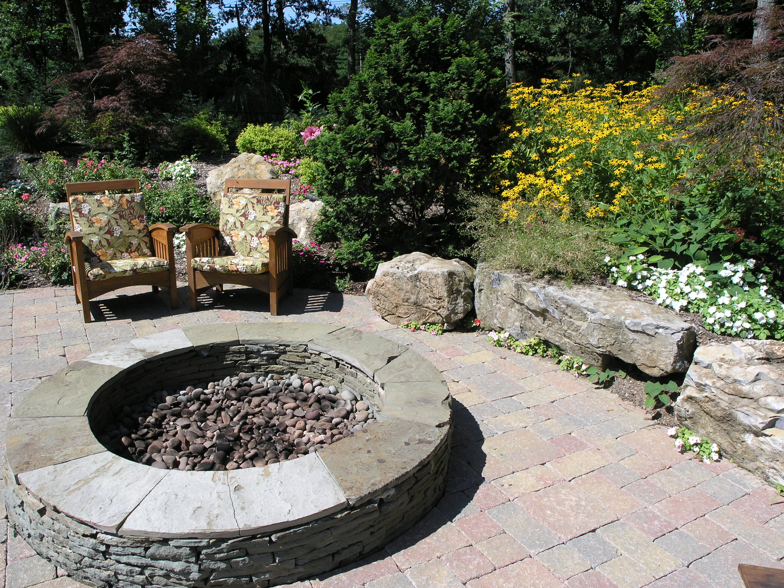 Landscape design with built in fire pit in Long Island, NY