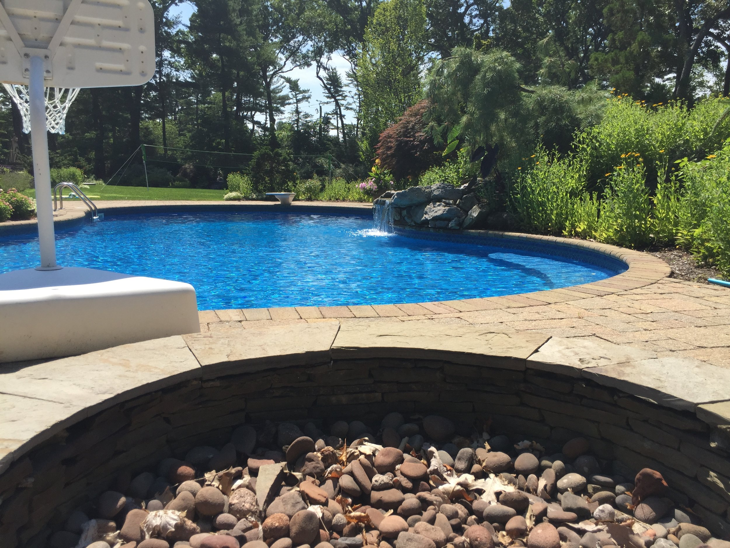 Top landscape design company with fire pitin Long Island, NY