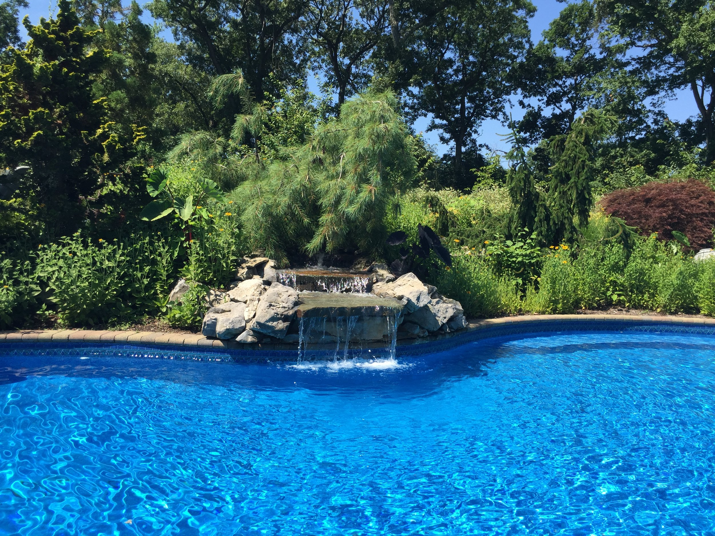 Top landscape design company with pool patioin Long Island, NY
