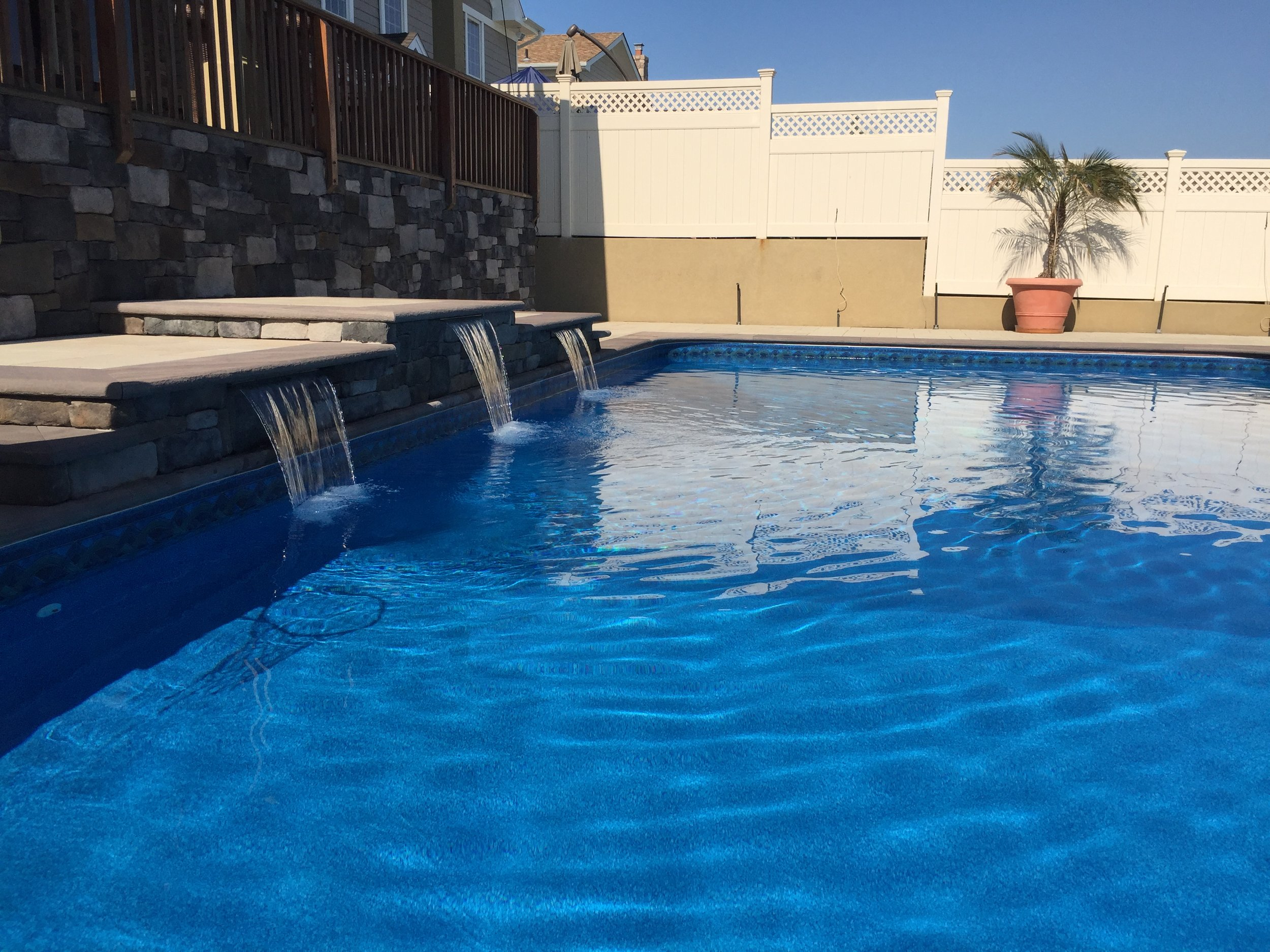 Top pool water feature landscape design company in Long Island, NY