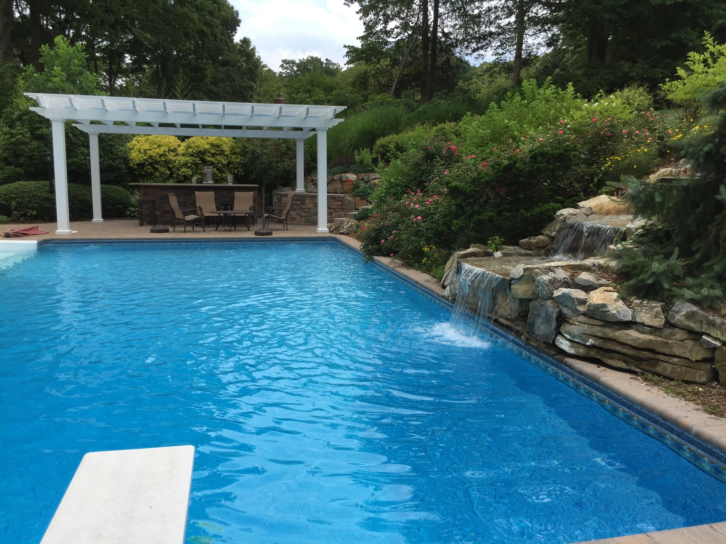 Professional landscape design with pool waterfall in Long Island, NY