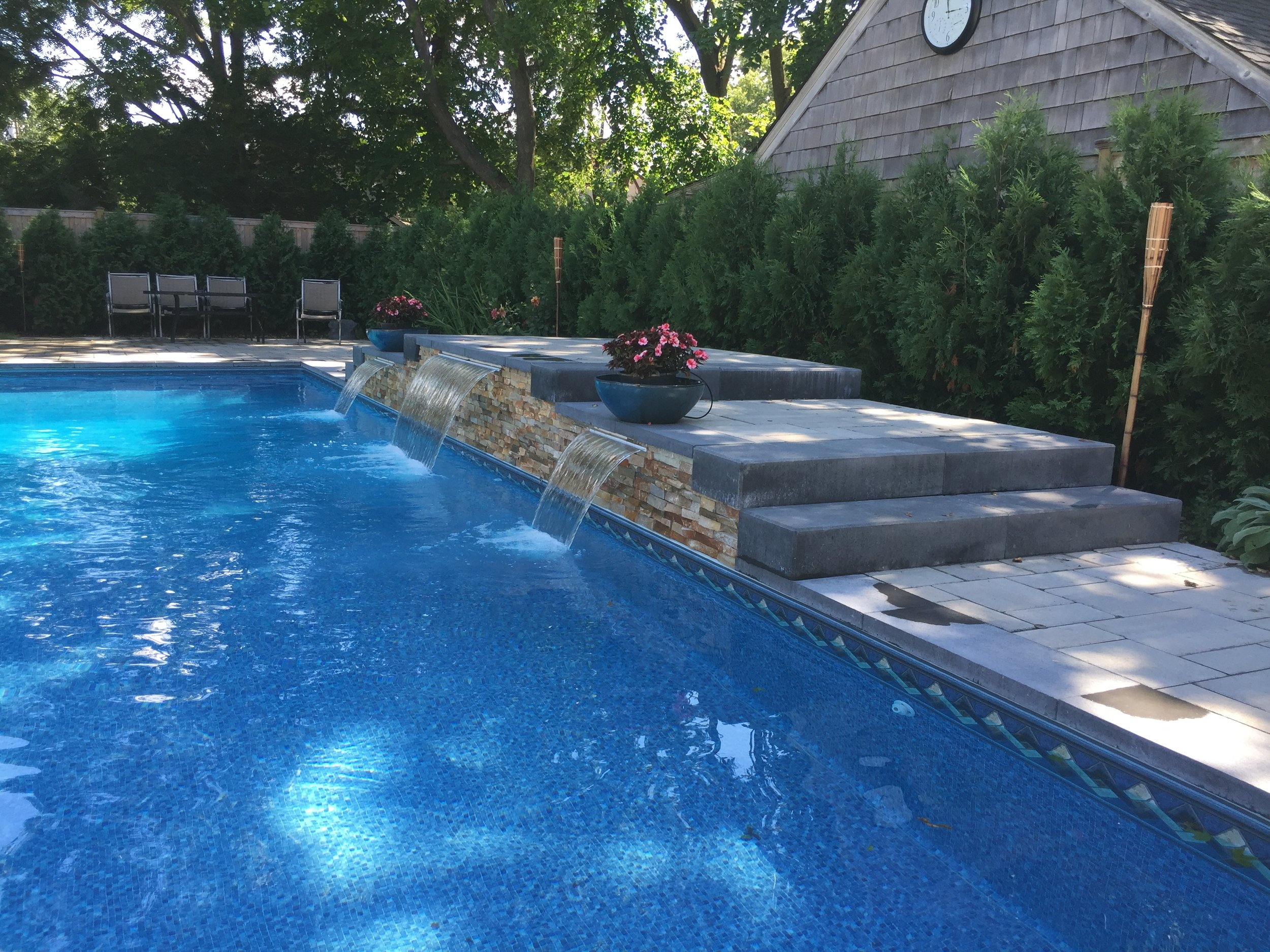 Experienced landscape design with pool water feature in Long Island, NY