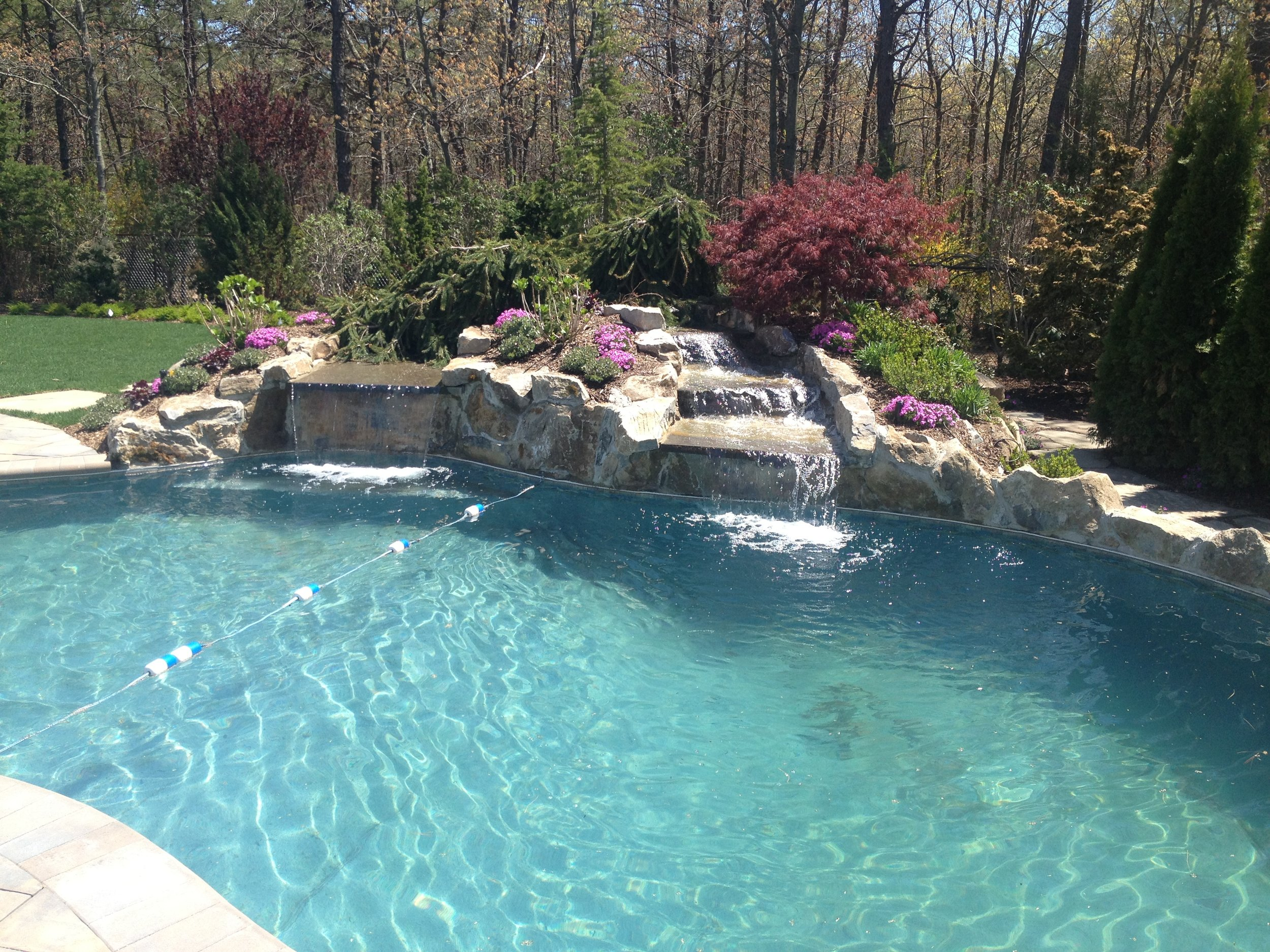 Professional landscape design with pool water feature in Long Island, NY