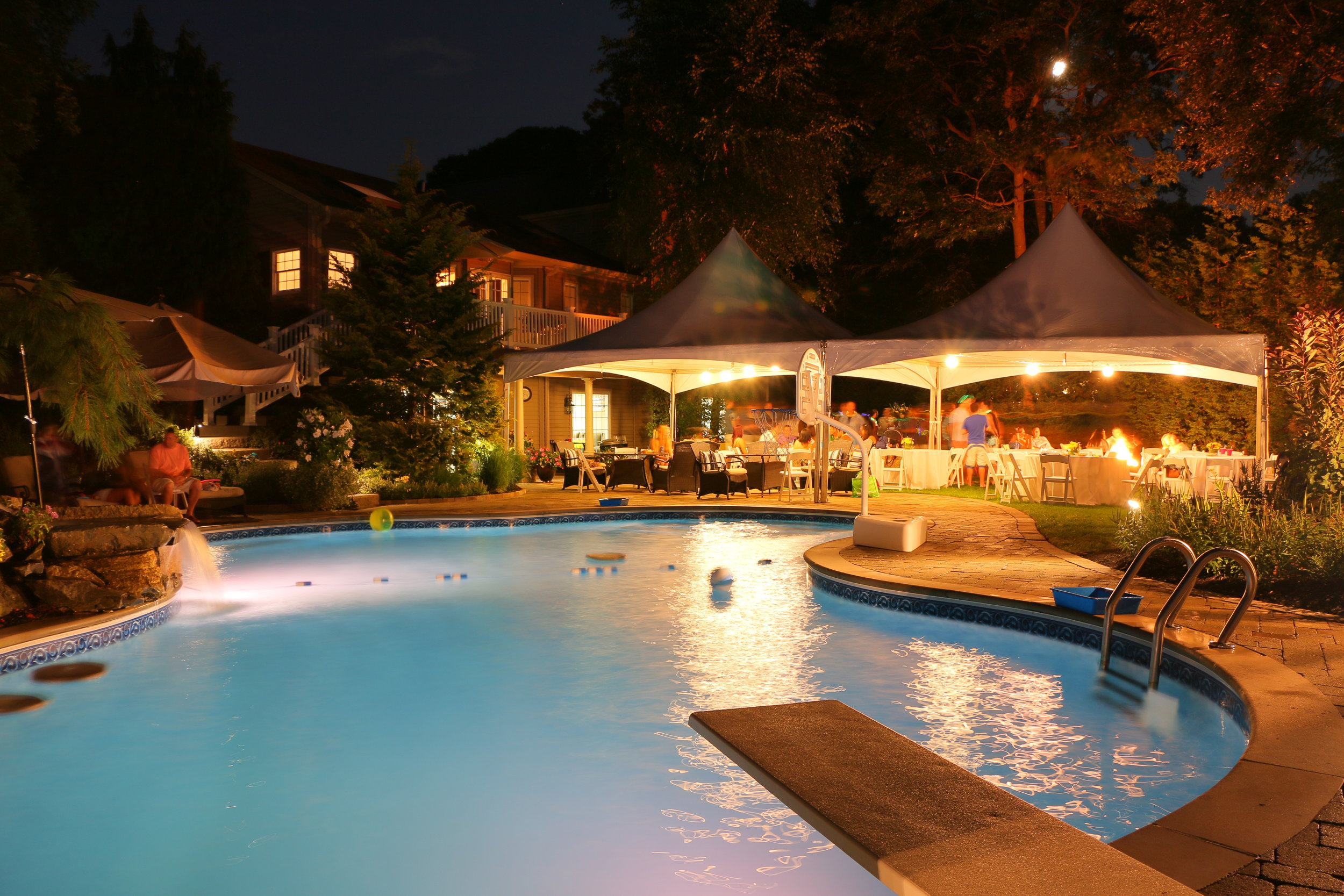 Landscape design with sheet descent lighting in Long Island, NY