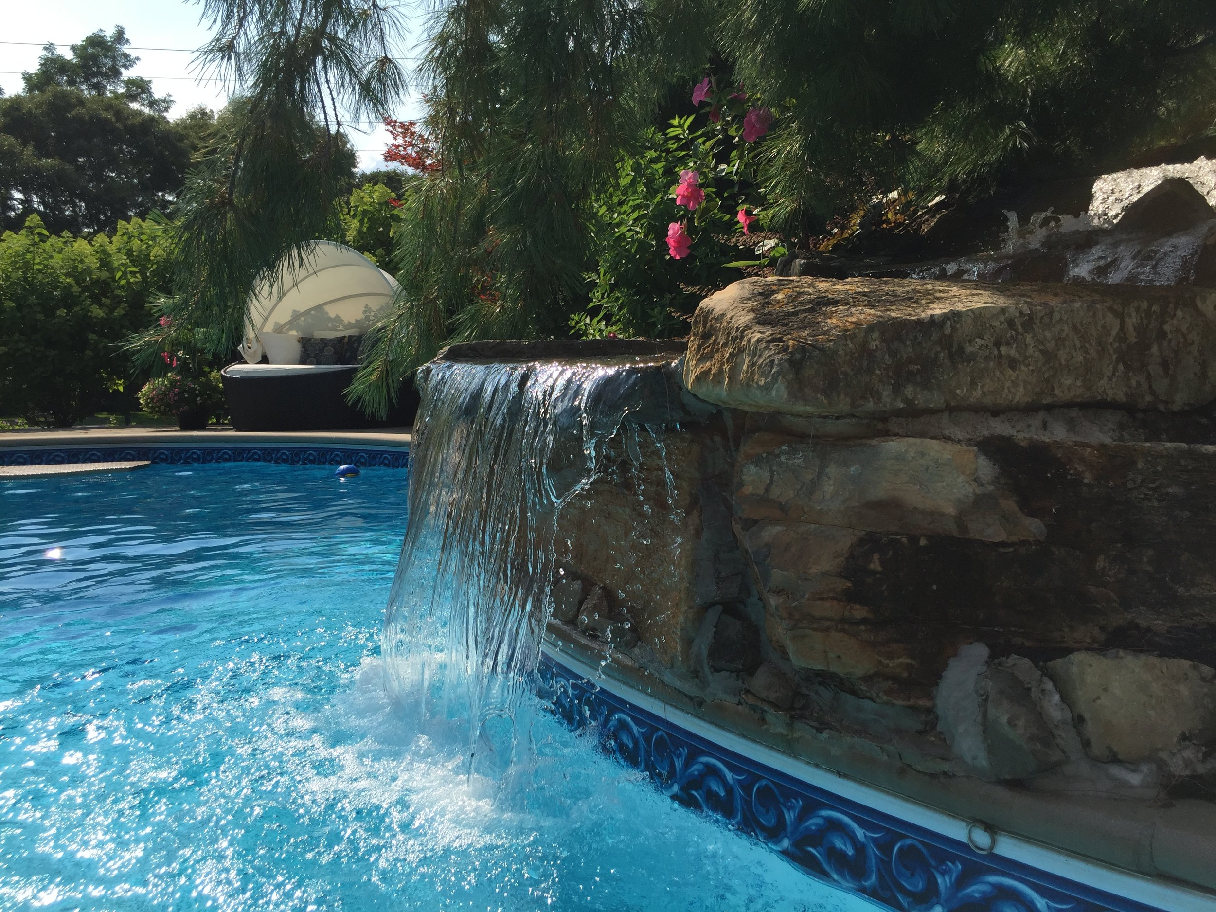 Professional pool waterfall landscape design company in Long Island, NY
