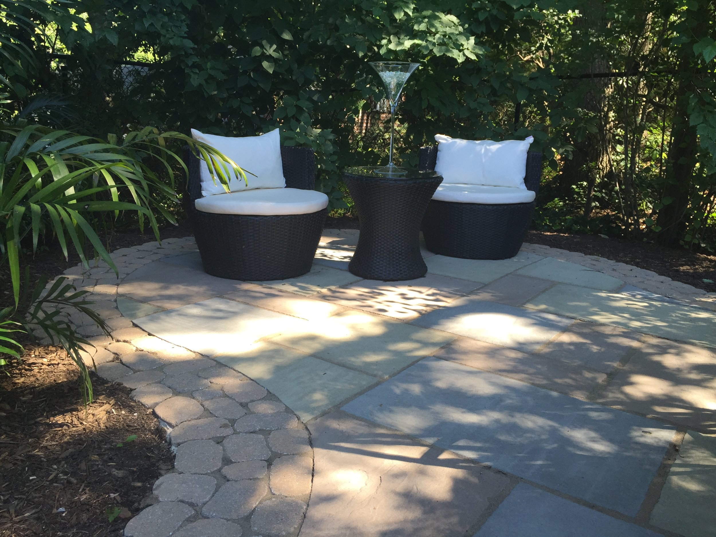 Landscape design with paved patio in Long Island, NY
