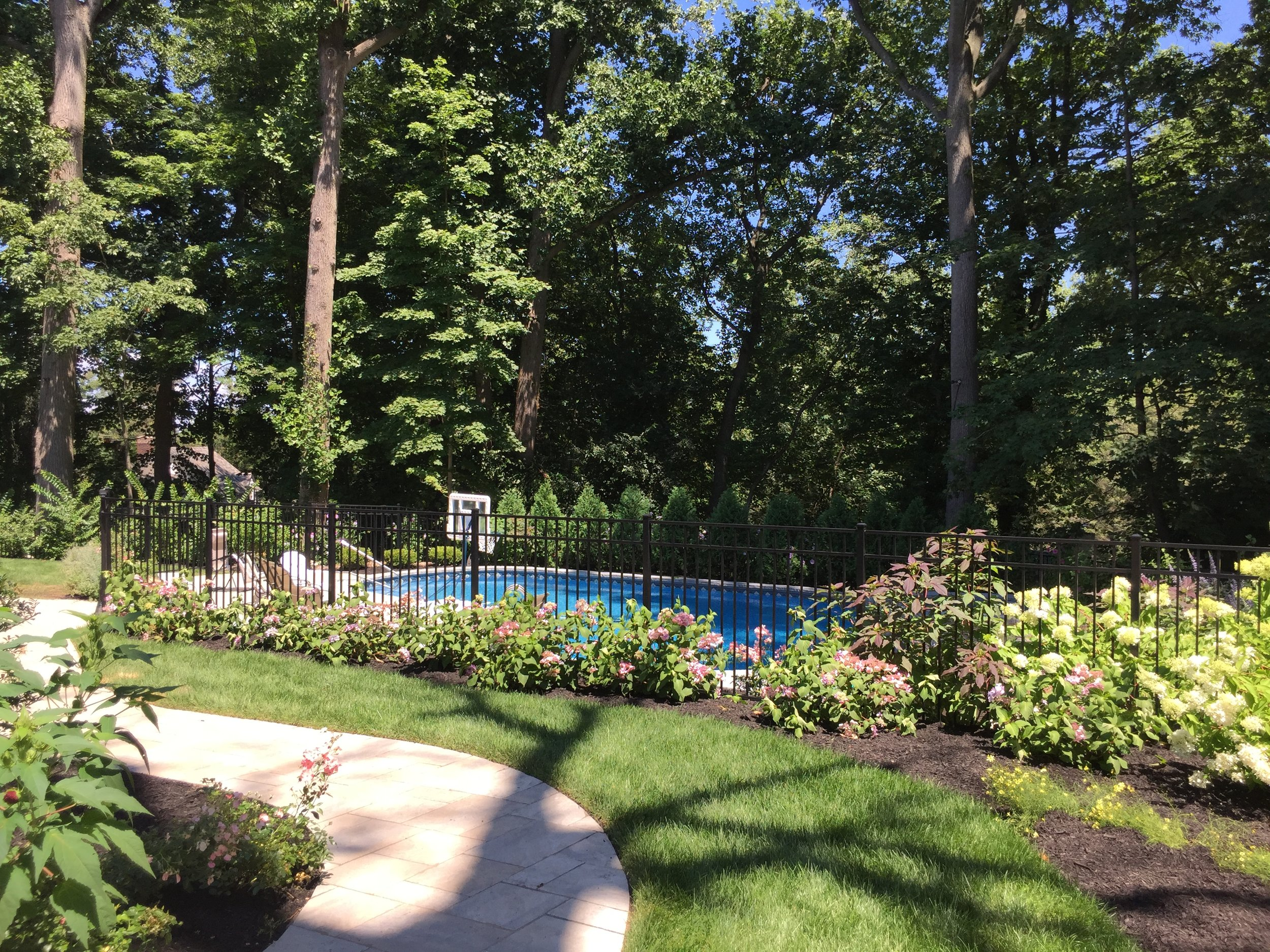 Landscape design with aluminum fence in Long Island, NY