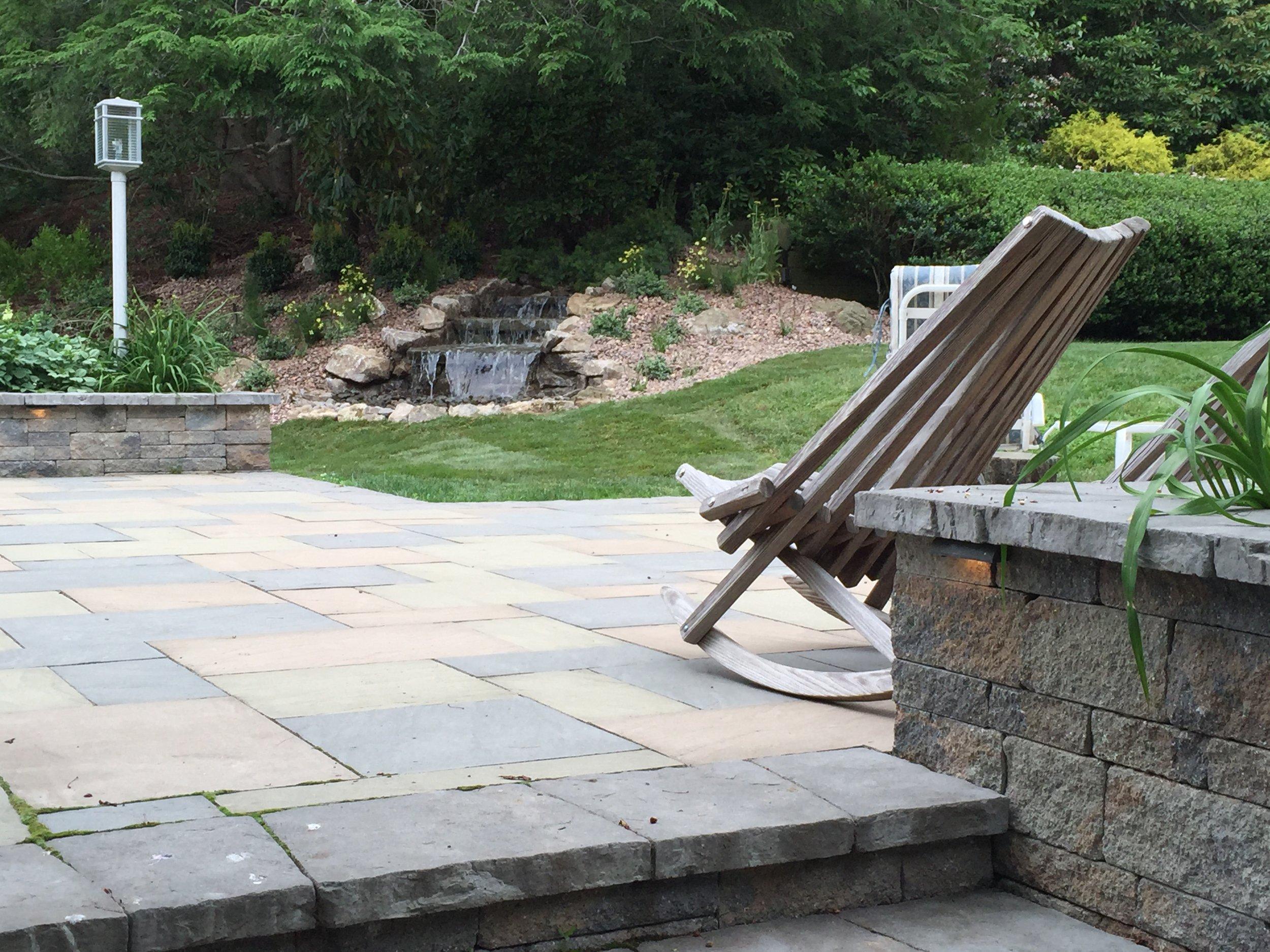 Landscape design with paved walkwayin Long Island, NY