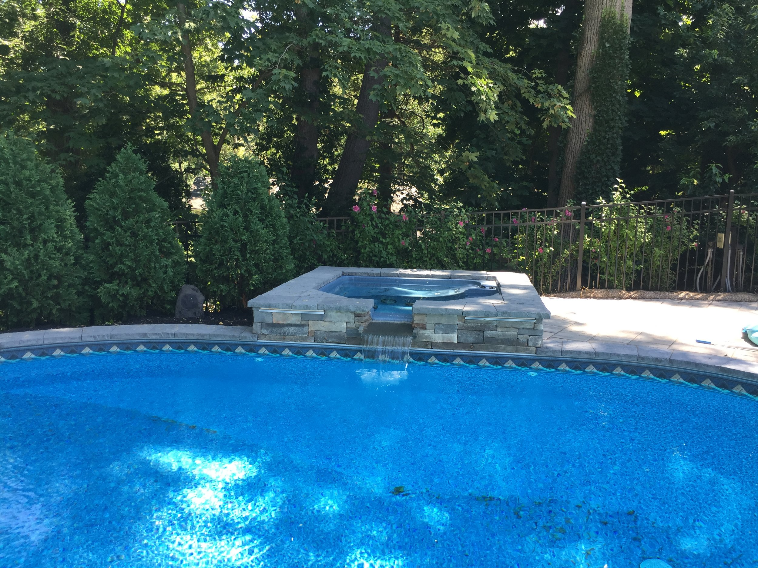 Landscape design with pool waterfallin Long Island, NY