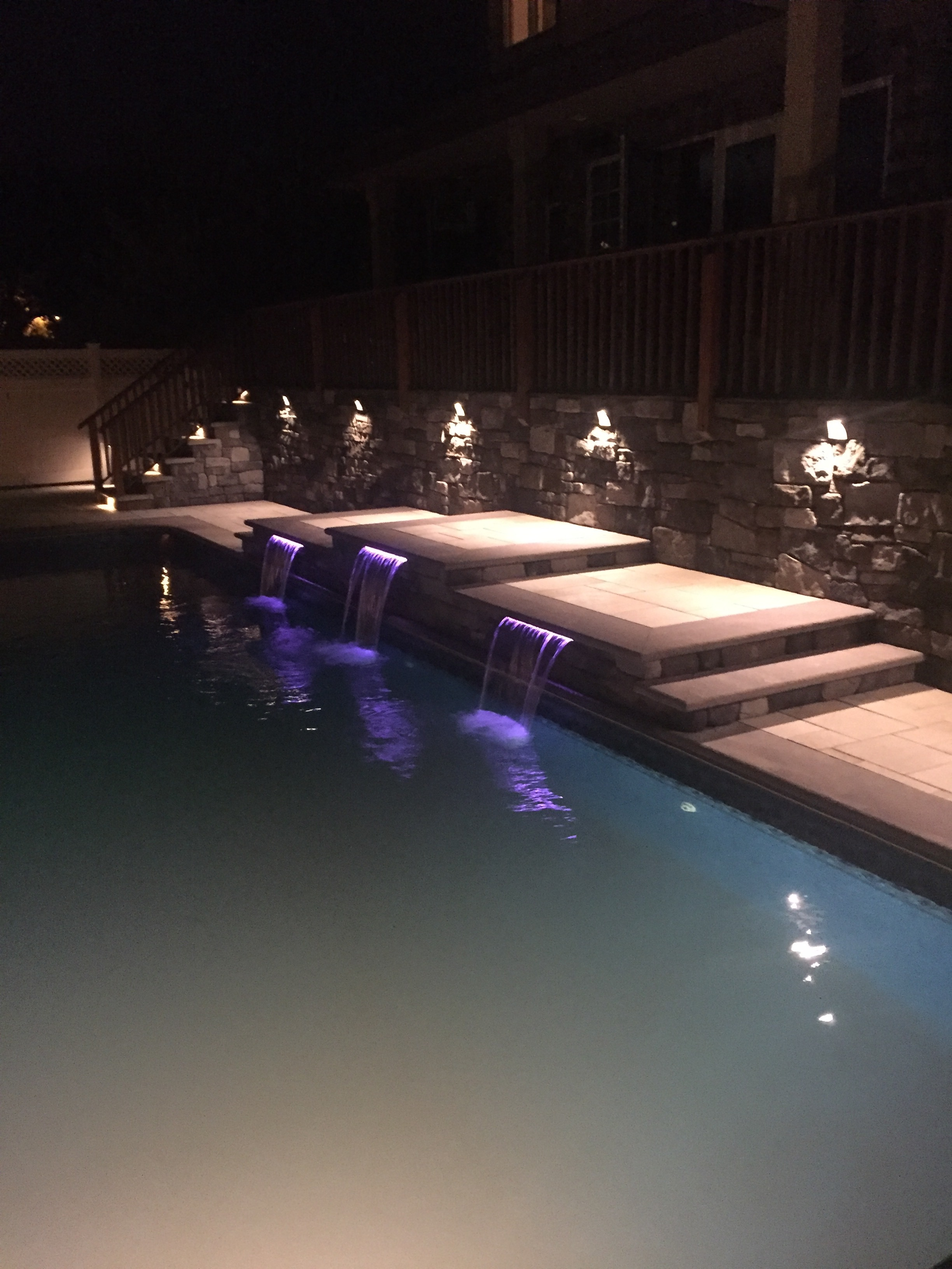 Landscape design with uplighting in Long Island, NY