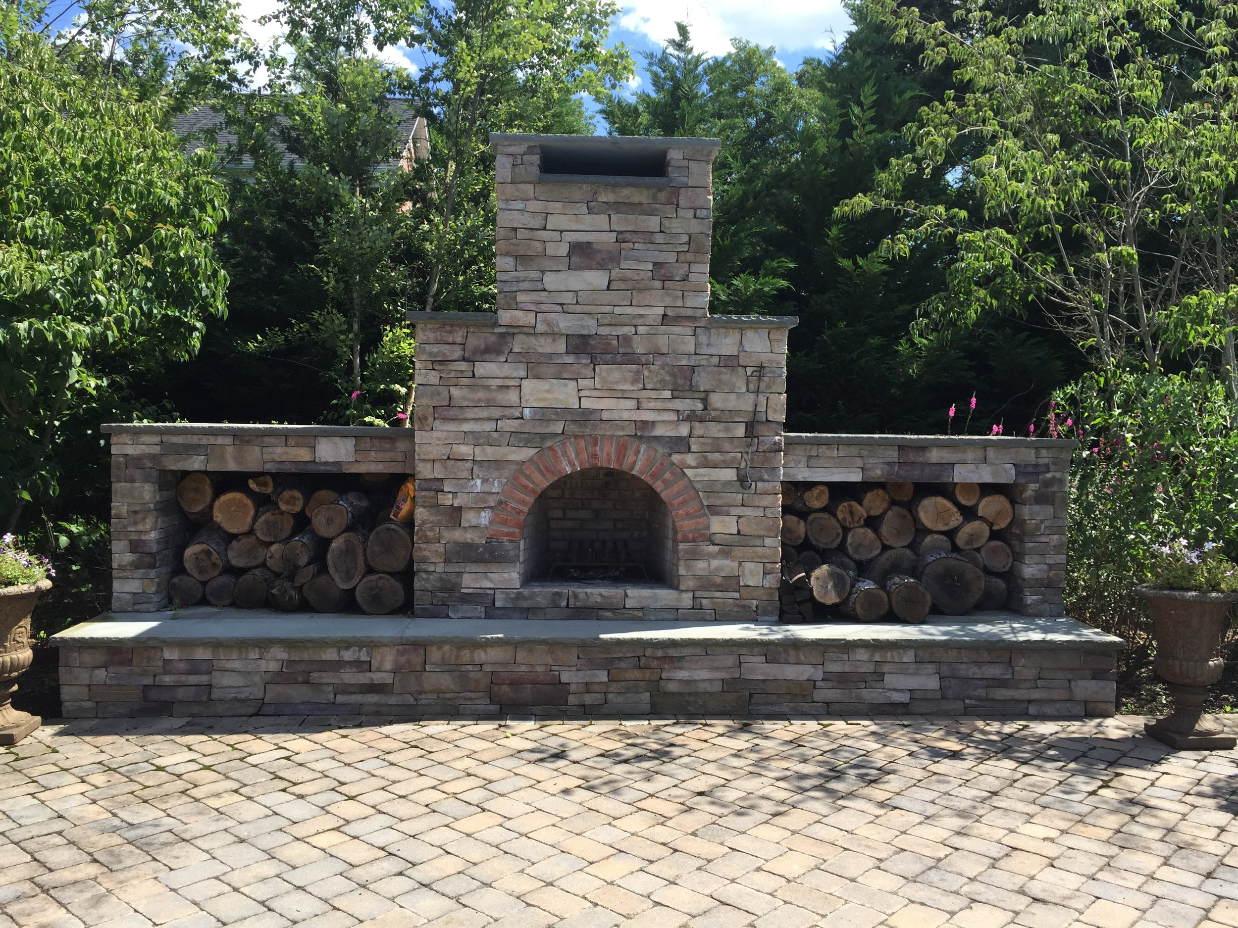 Top outdoor fireplace landscape design company in Long Island, NY