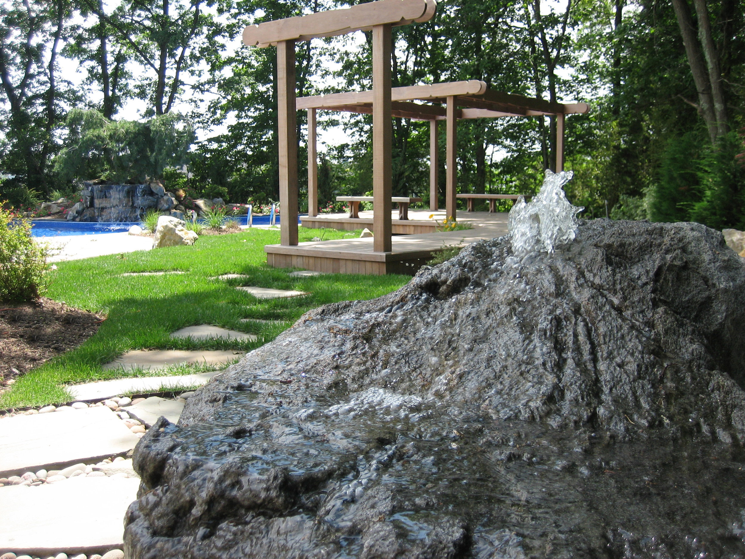 Top landscape design with water fountain in Long Island, NY