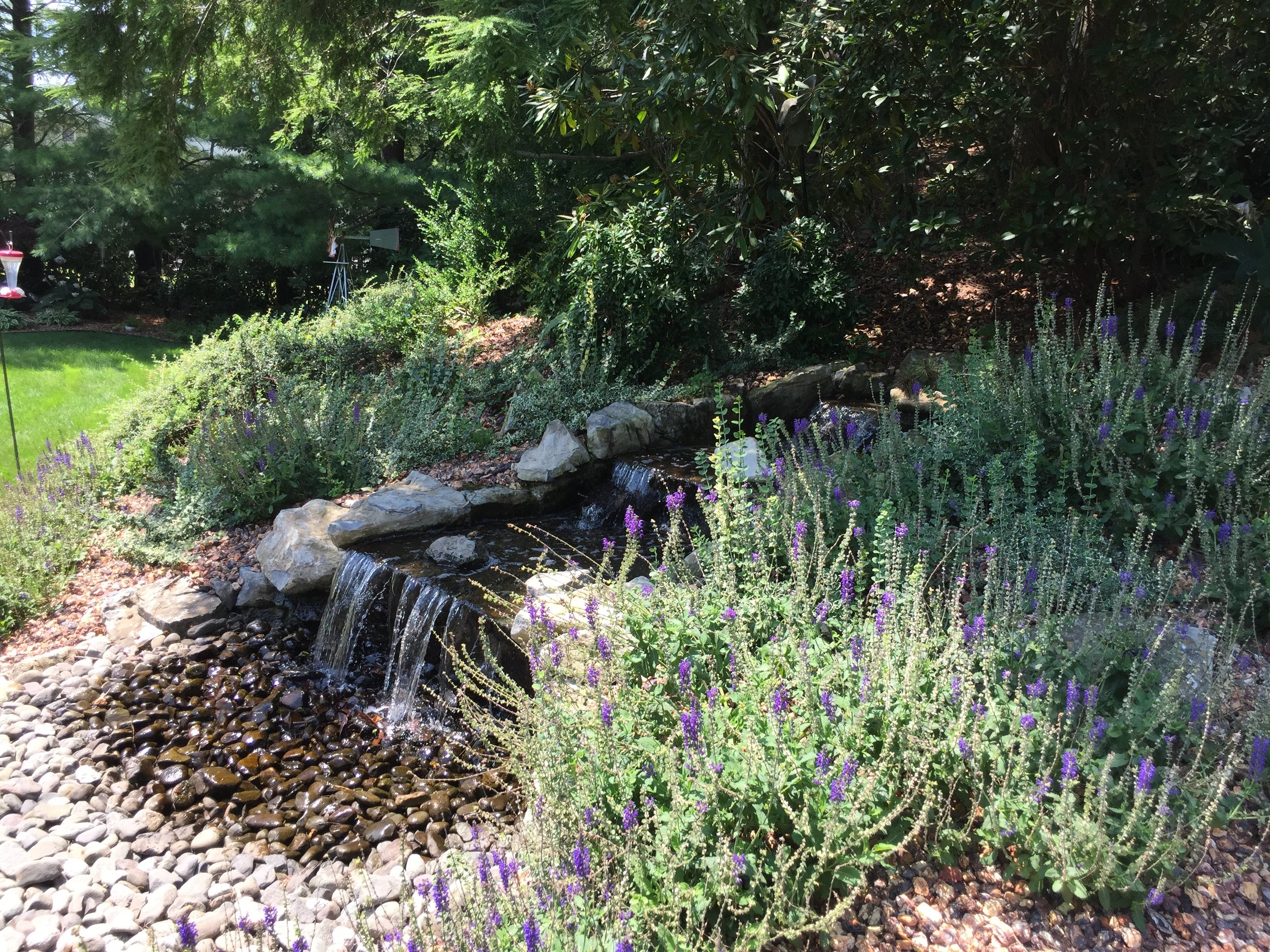 Experienced landscape design with water feature in Long Island, NY