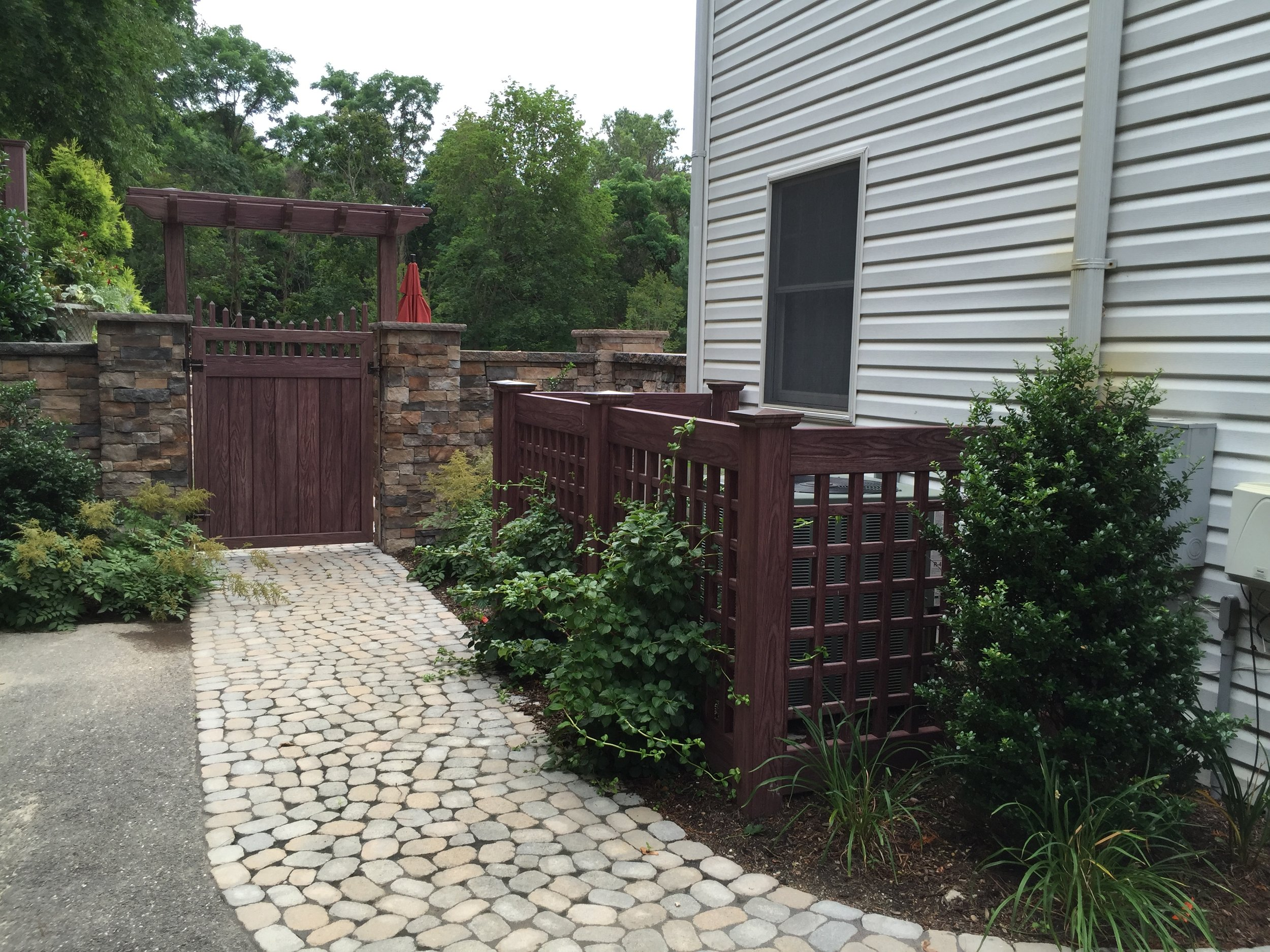 Top landscape design with fence gatein Long Island, NY