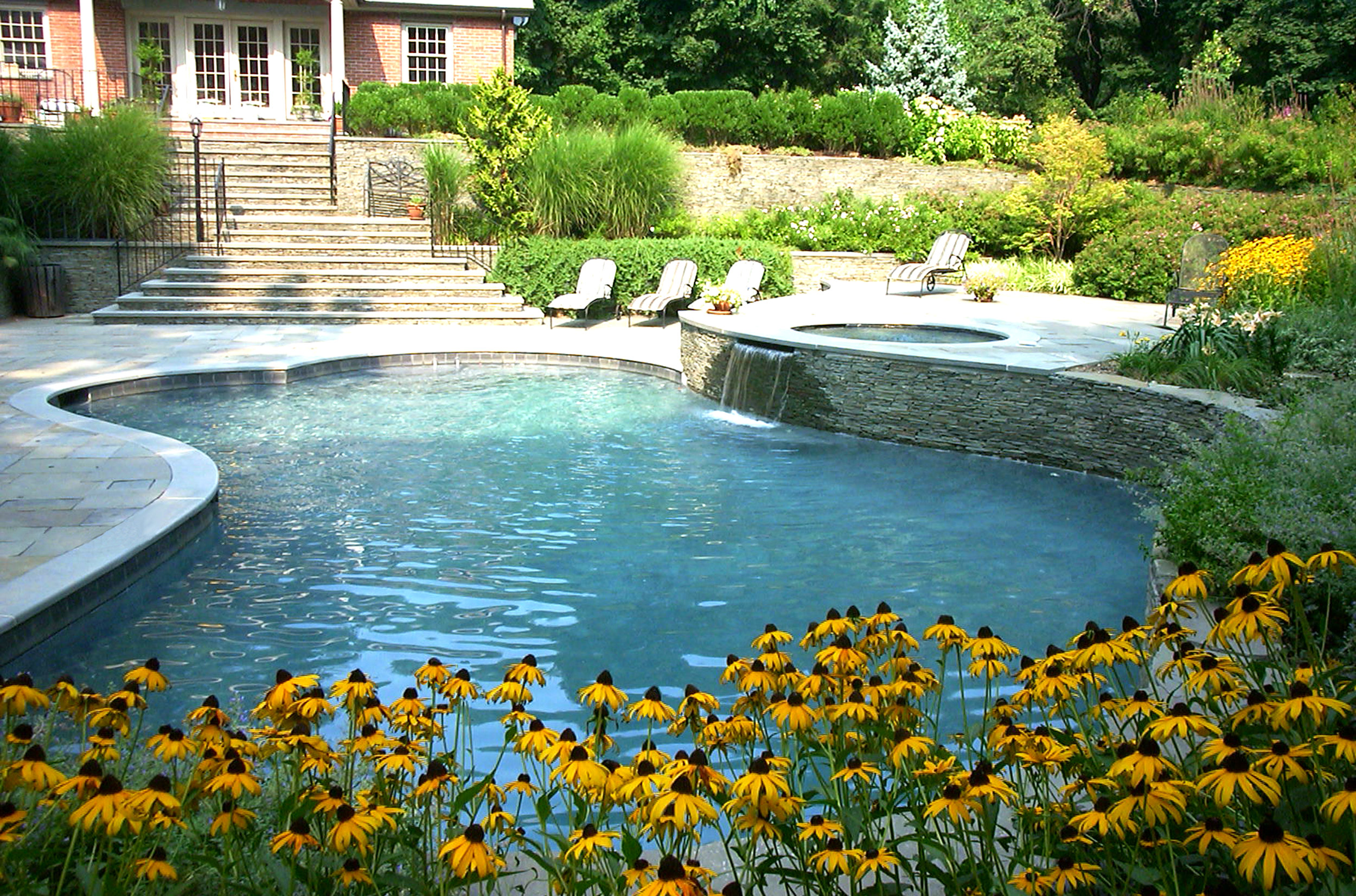 Landscape design with pool plantings in Long Island, NY
