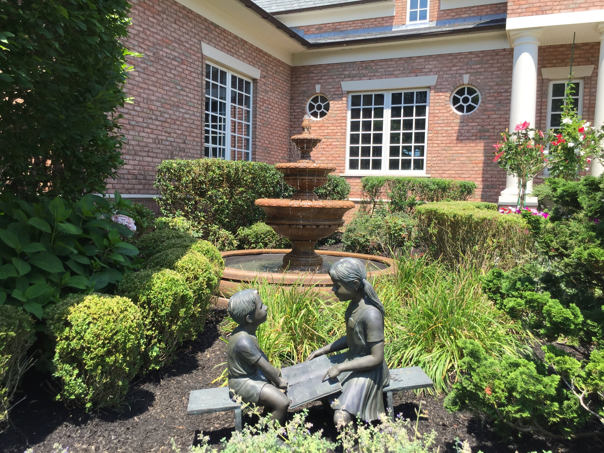 Top landscape designer with garden water feature in Long Island, NY