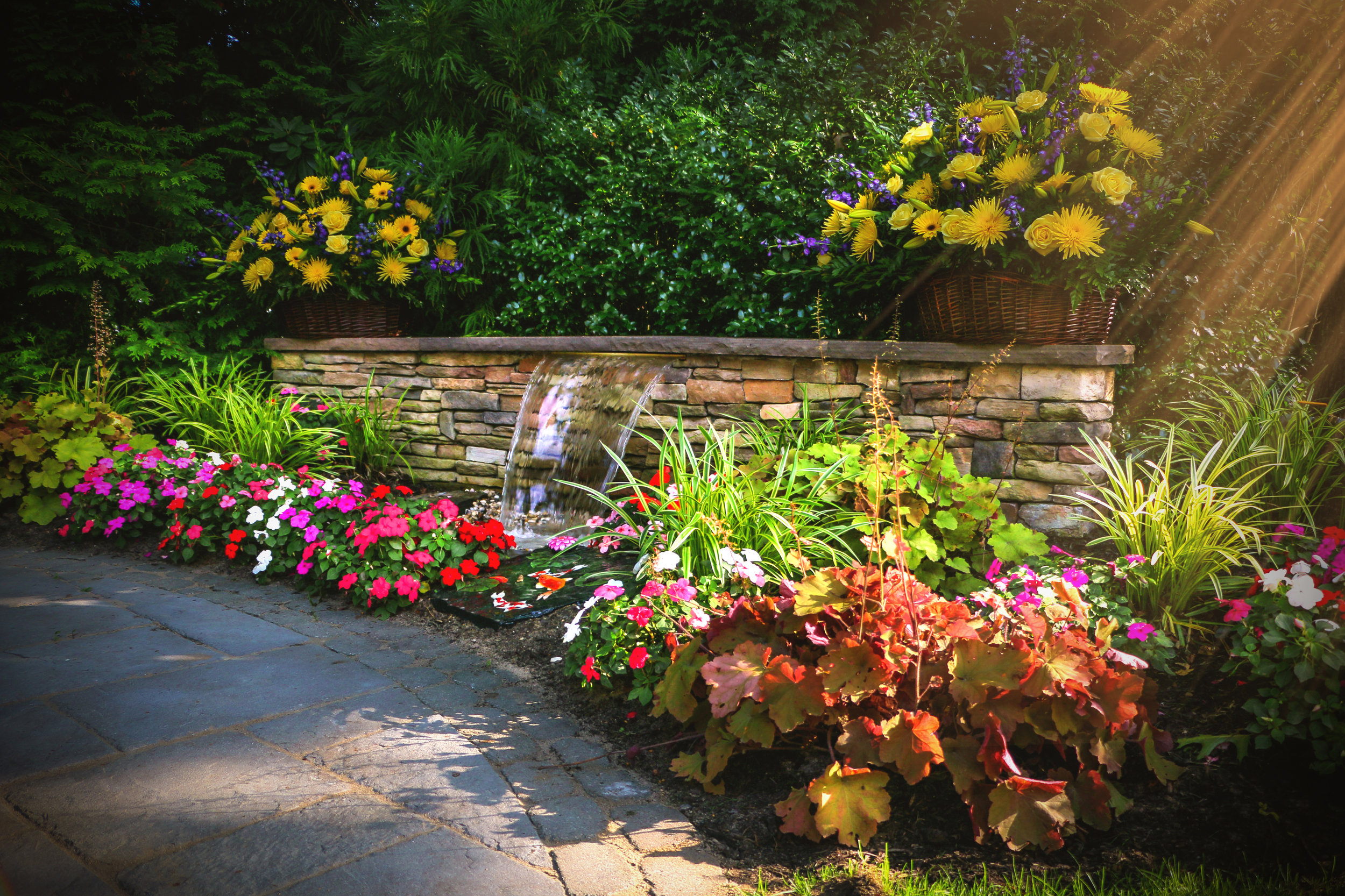 Top landscape design with garden water feature in Long Island, NY
