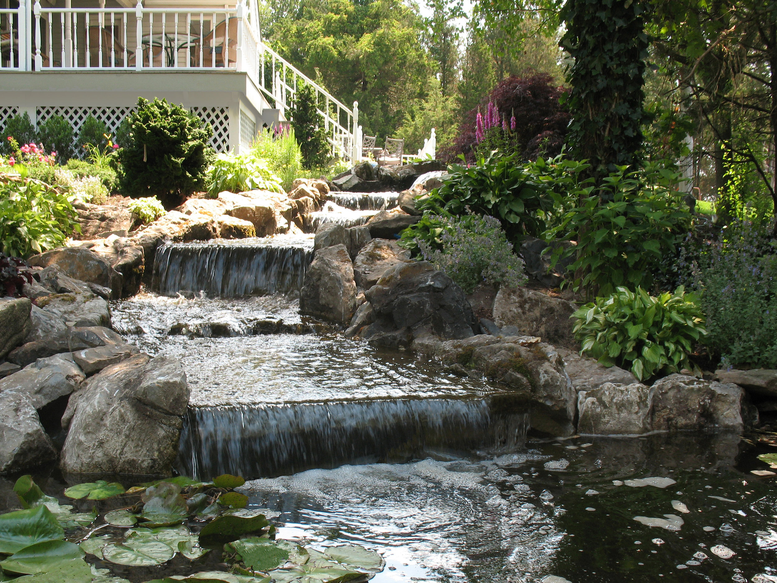 Professional landscape designer with garden water feature in Long Island, NY