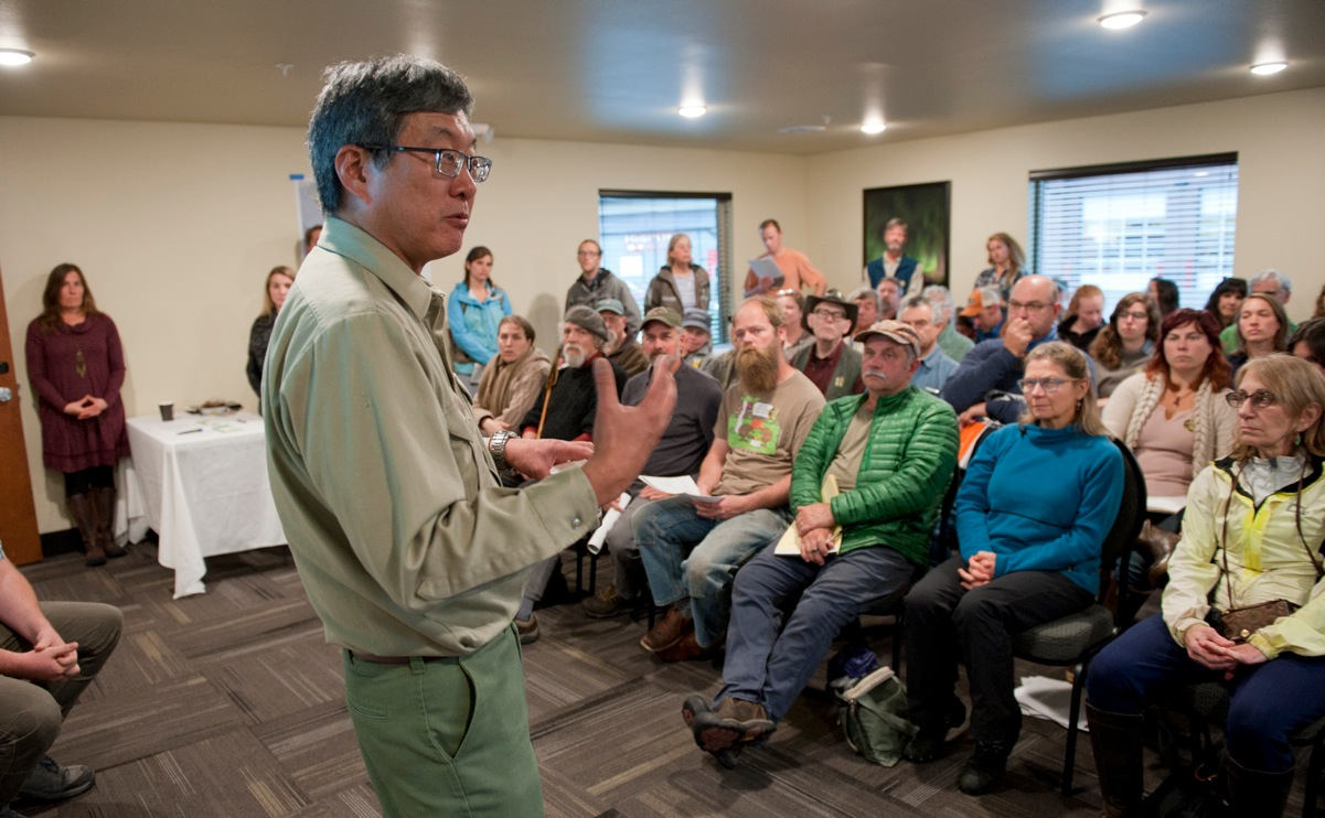 Kenneth Tu, U.S. Forest Service regional administrative review coordinator, takes questions at a public meeting to discuss changes to the 2001 Roadless Rule. More than 50 Sitkans packed into a conference room at the Aspen Suites Hotel for the meeting. (Sentinel Photo by James Poulson)