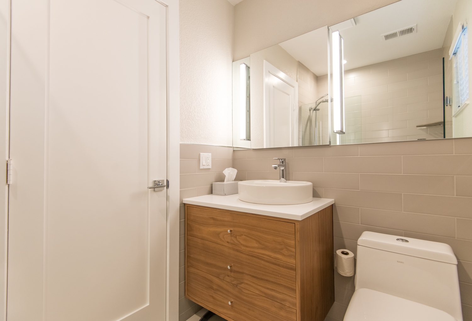 Second bath features new cabinets, Corian countertops and high-end fixtures.