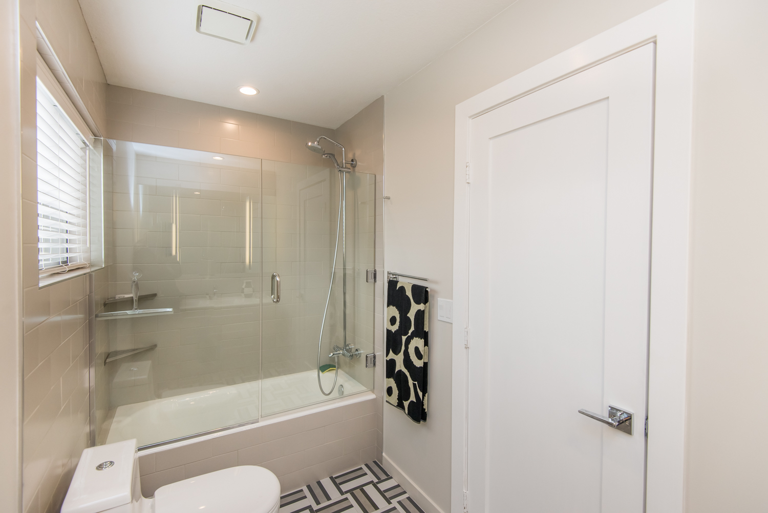 Tub-shower with glass enclosure completes the master bath.