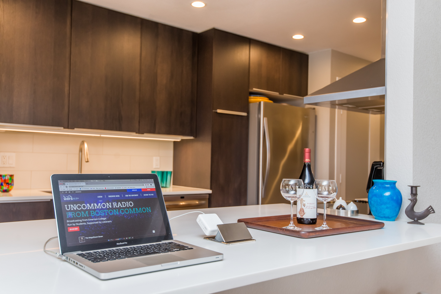 Kitchen bar features a pop-up outlet for laptops or phone charging.