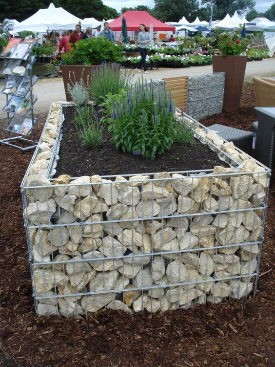 Garden edging or raised garden bed  Image via  HERE
