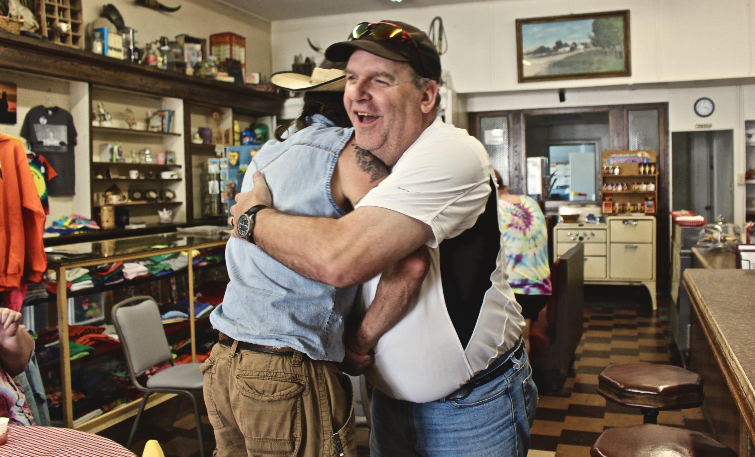 Bob and Jimmy hug hello after a long time apart