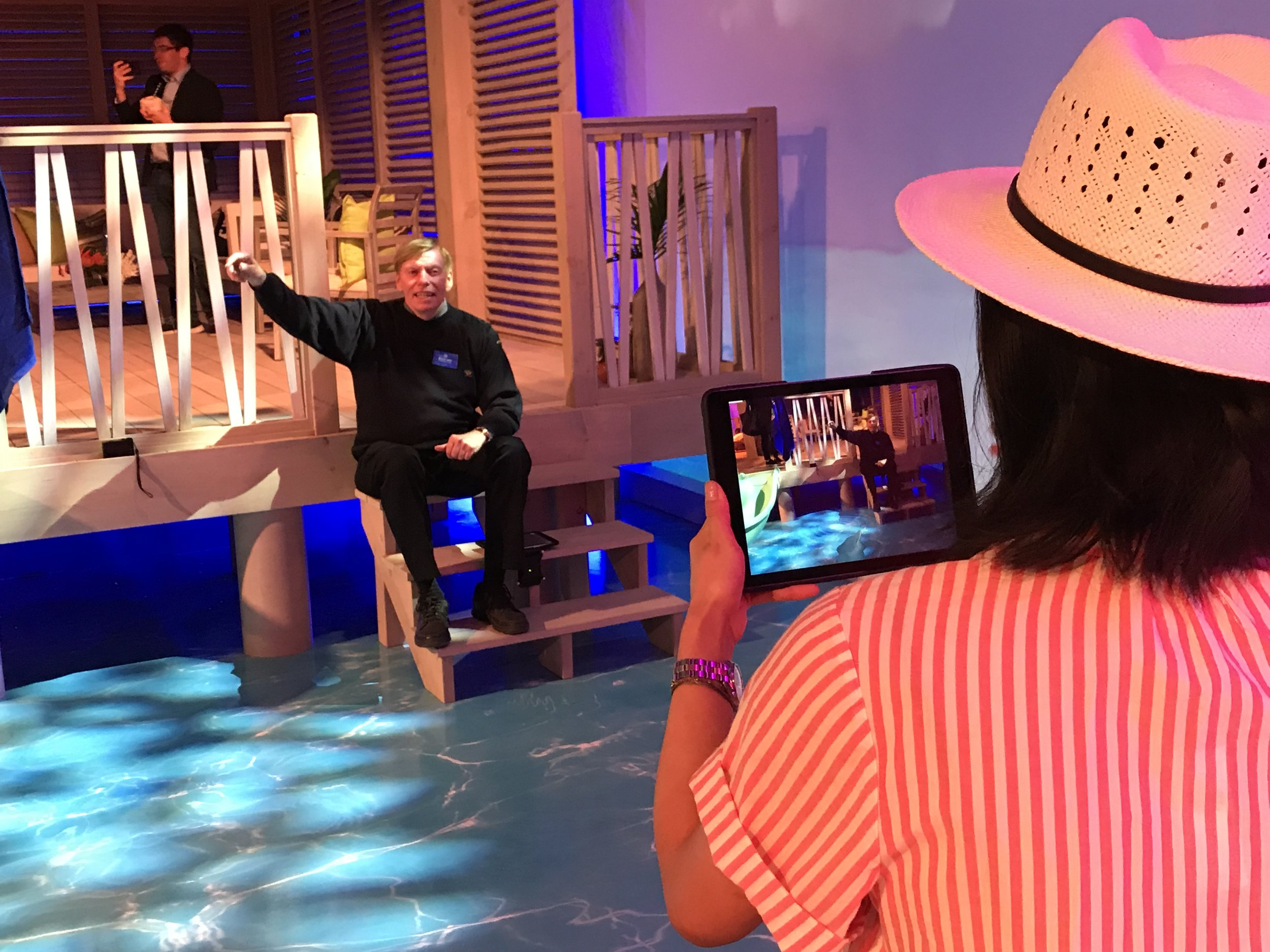A guests takes a video with an augmented reality dolphin!