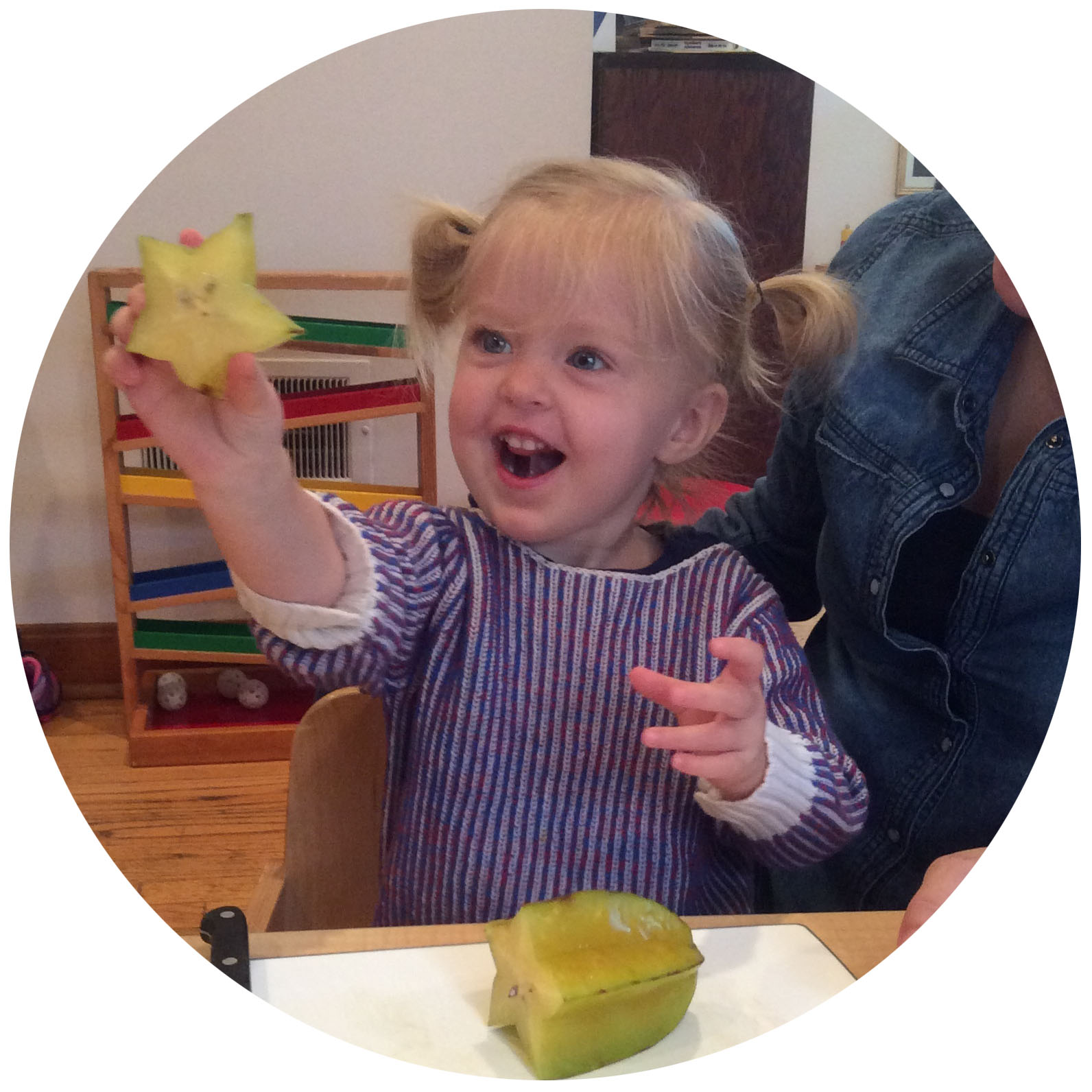 toddler cut starfruit.jpeg